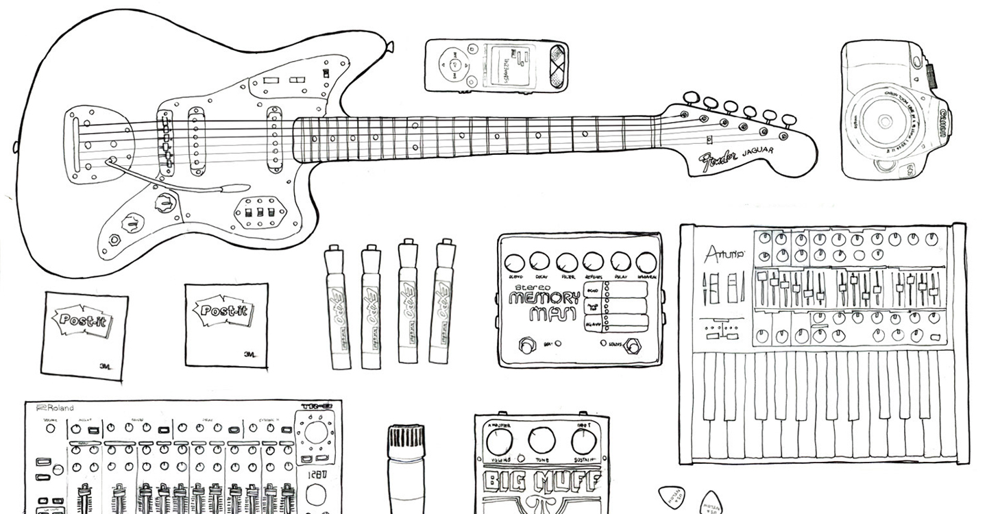 Drawing of a guitar, musical instruments, a camera and other design tools.
