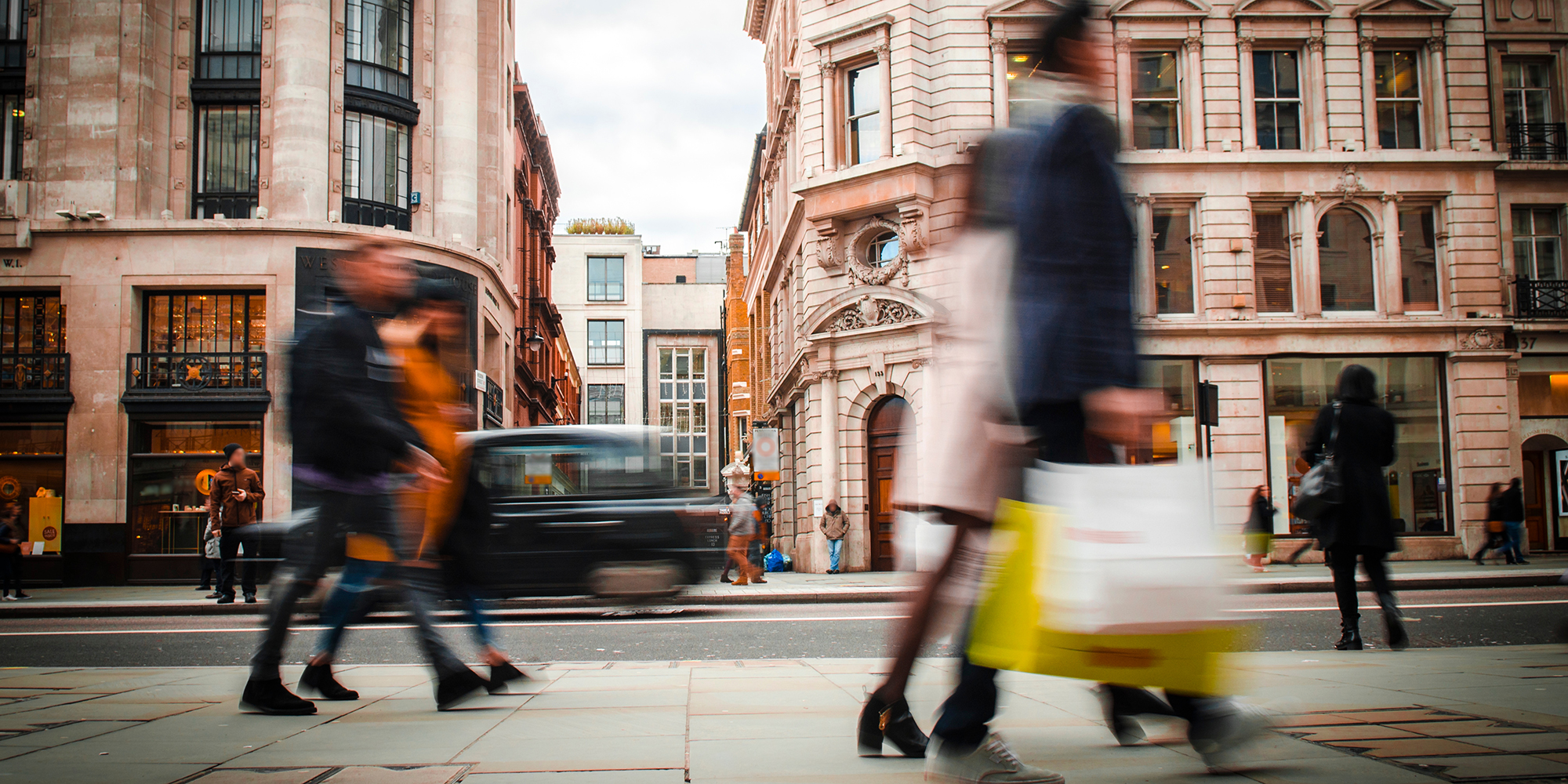 Image of shoppers on busy street in London