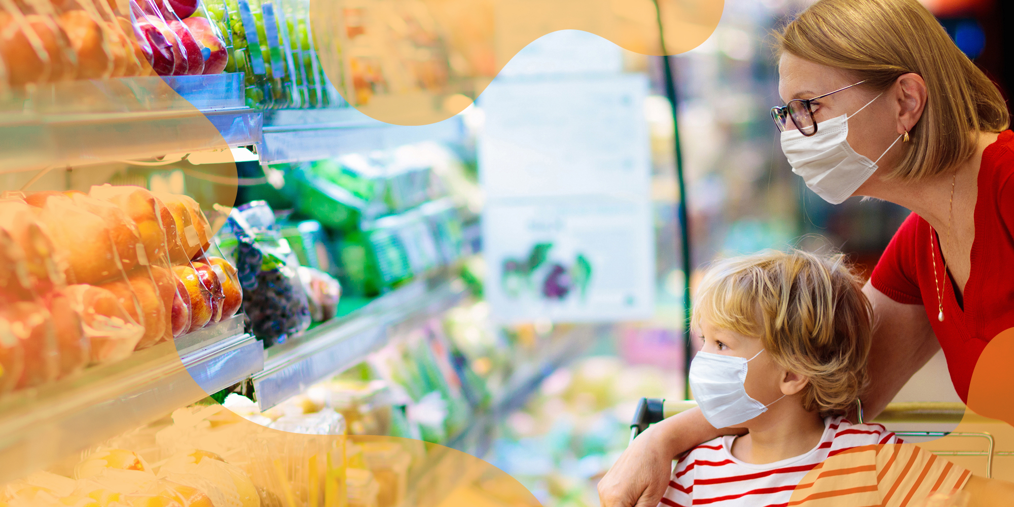mother and child grocery shopping while wearing covid face coverings