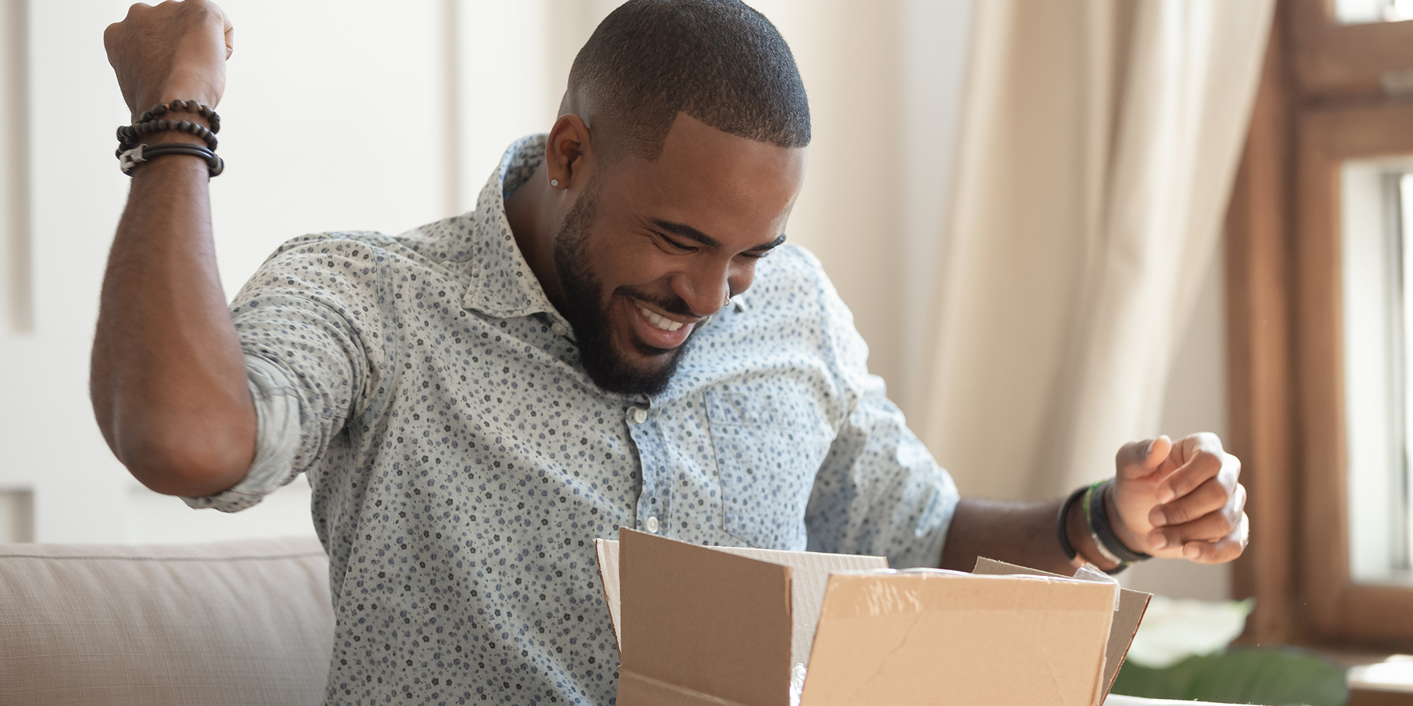man excited to receive ecommerce package