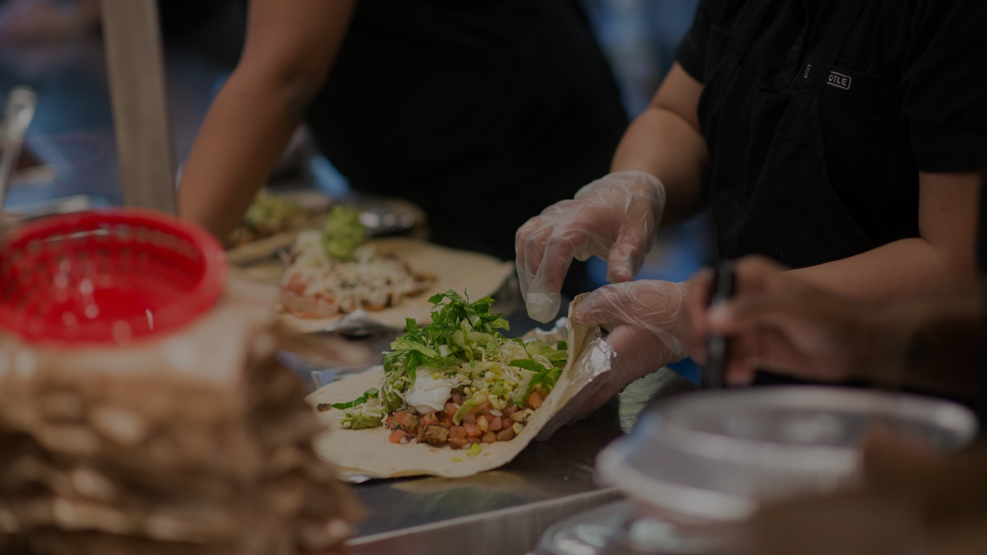 Chipotle Employee making burrito